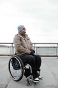 Man-in-wheelchair-exploring-seaside-village
