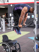 Man-using-wheelchair-at-gym-training-session