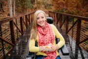 Woman-in-power-wheelchair-in-riverside-park-during-fall