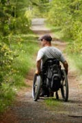 Man-in-wheelchair-in-country-lane