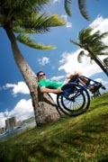Man-in-wheelchair-enjoying-an-Hawaiian-coastal-park