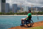 Man-in-wheelchair-beach-fishing-in-Hawaii
