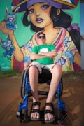Man-in-wheelchair-taking-in-street-art