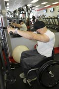 Man-in-wheelchair-working-out-at-gym