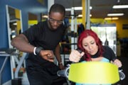Personal-Trainer-Assisting-Disabled-Woman