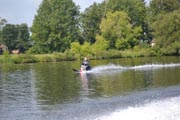 Man-waterskiing-on-lake-with-sit-ski