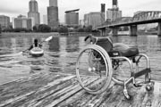 Young-paraplegic-woman-canoeing-on-city-river