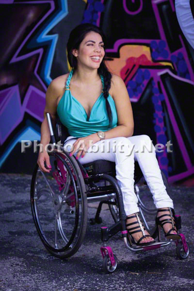 Young woman in a wheelchair admiring street art