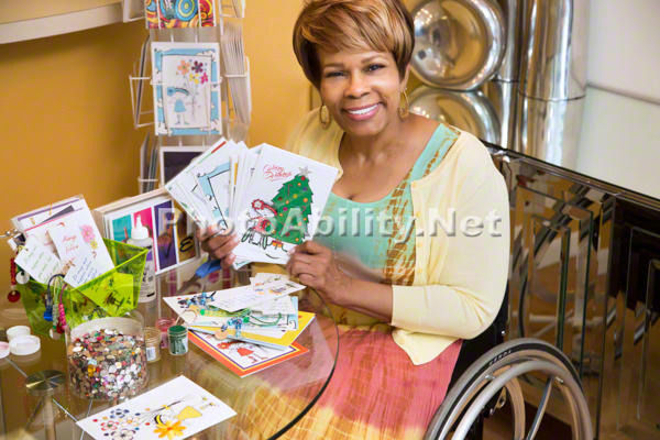 Woman using a wheelchair making gift cards
