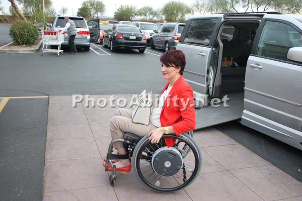 Woman in a wheelchair going shopping with her accessible van.