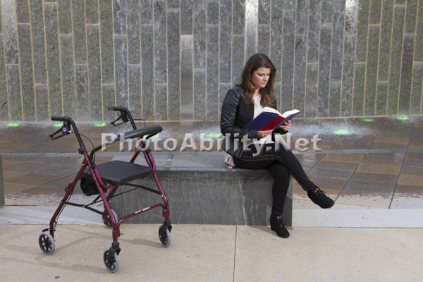 Young woman with a mobility aid exploring the city