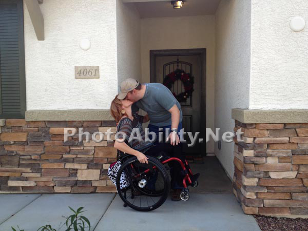 Couple kissing on the threshold of new home