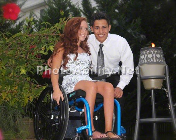 Young woman in a wheelchair with her boyfriend dressed up for Homecoming