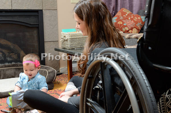 Young mother using a wheelchair with her baby