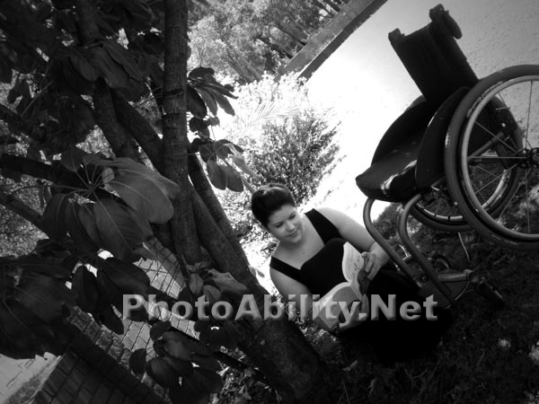 Young in a wheelchair in the garden with her dog