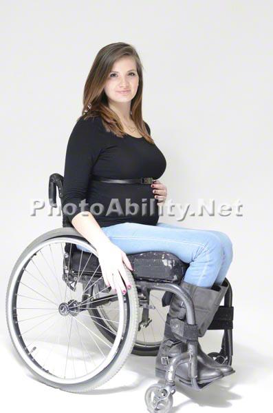 Pregnant Mom in wheelchair portrait on white