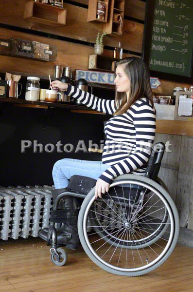 Pregnant Mom in wheelchair at a coffee shop