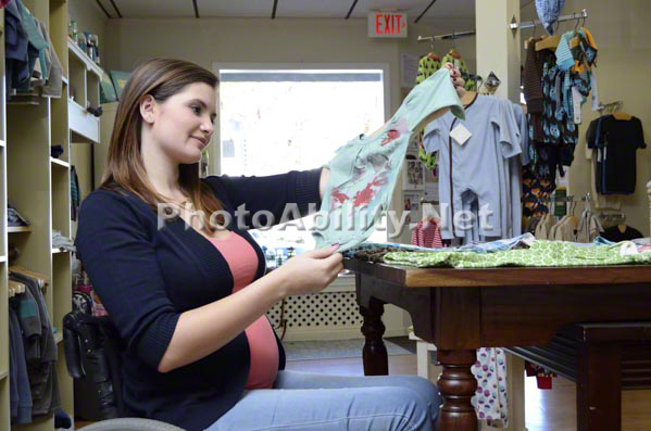 Pregnant Mom in wheelchair shopping for new baby