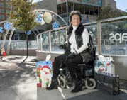Mature-woman-in-power-wheelchair-doing-her-Christmas-shopping-in-the-city