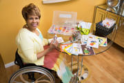 Woman-using-wheelchair-making-gift-cards