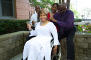 Woman-using-wheelchair-celebrating-in-the-office-with-her-co-workers