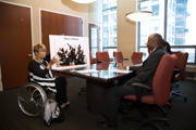 Woman-using-wheelchair-presenting-in-board-meeting