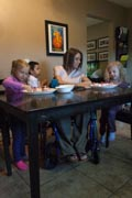 Young-mother-in-wheelchair-making-cupcakes-with-her-children