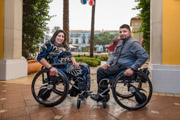 Young-couple-in-wheelchairs-in-city-square