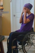 Young-mother-to-be-in-wheelchair-preparing-dinner-with-her-family