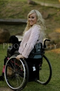 disabled;disability;wheelchair;female;woman;outdoors;garden;smiling