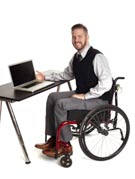Business-man-in-wheelchair-using-his-laptop