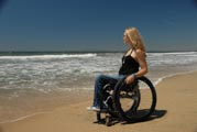 Woman-in-wheelchair-on-the-beach-featuring-Teal-Sherer,-