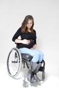 Pregnant-Mom-in-wheelchair-portrait-on-white