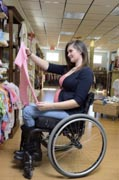 Pregnant-Mom-in-wheelchair-shopping-for-new-baby