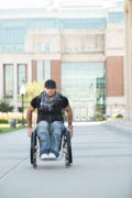Young-man-in-wheelchair-studying-on-campus