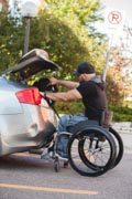 Young-male-college-student-in-wheelchair-getting-into-his-car