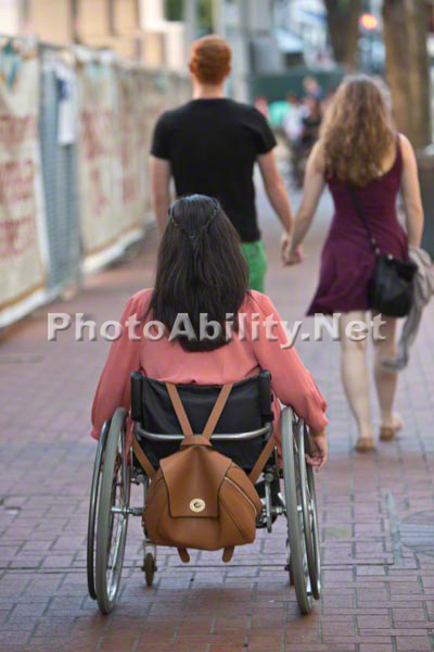 Young woman in a wheelchair shopping with her friend