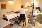 Female-doctor-in-wheelchair-with-her-patient-in-an-examination-room
