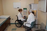 Feamle-doctor-in-wheelchair-discussing-case-with-her-colleague