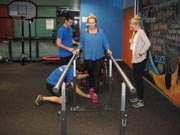 Physical-Therapists-Assisting-Young-Female-With-A-Disability
