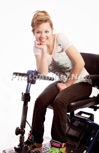Woman with a mobility scooter in a studio portrait