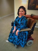 Woman-using-power-wheelchair-at-en-evening-reception