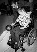 Girl-in-wheelchair-with-her-father-at-bowling-alley