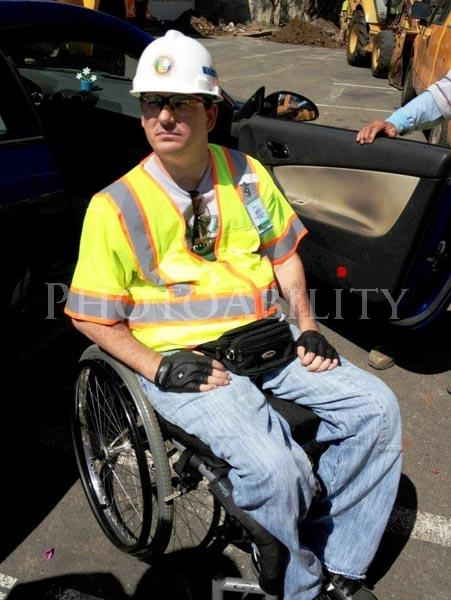 Male construction worker in a wheelchair on the job