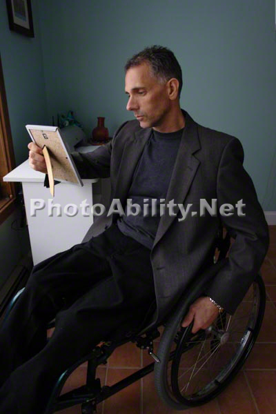 Detective in a wheelchair reviewing a crime scene