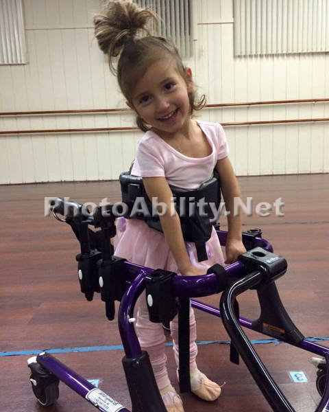 Young girl in an adaptive ballet lesson