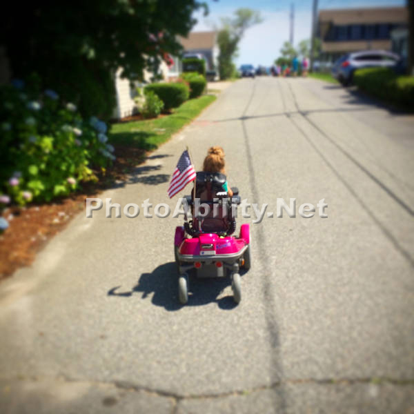 Young girl exploring in her pink power wheelchair