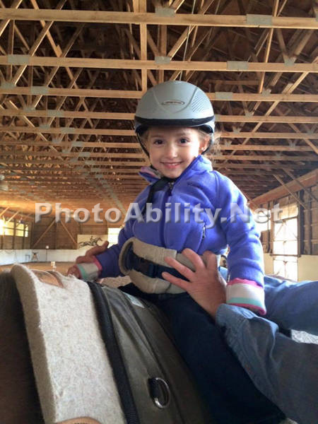 Young girl adaptive horse riding