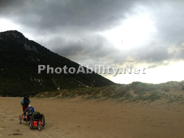 A group of people on a three day wilderness hike with a handcycle