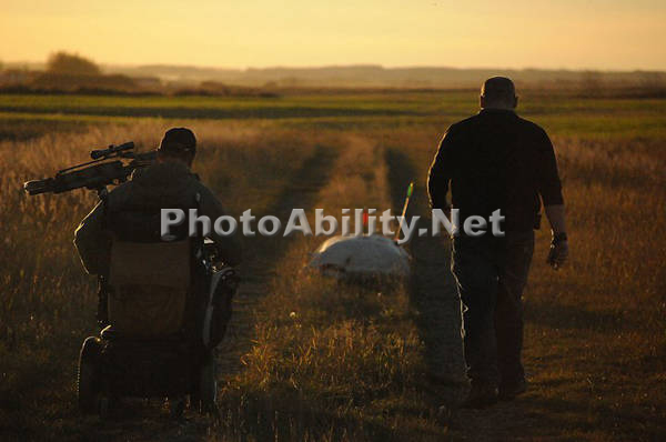 Two men hunting at sunset